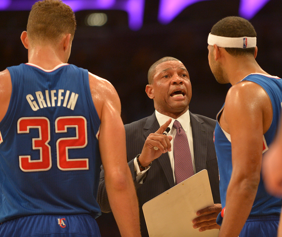 . Clippers Head Coach Doc Rivers talks with his players during a break in the action in the first half. The Los Angeles Lakers played the Los Angeles Clippers in the opening game of the season at Staples Center. Los Angeles, CA. 10/29/2013. photo by (John McCoy/Los Angeles Daily News)