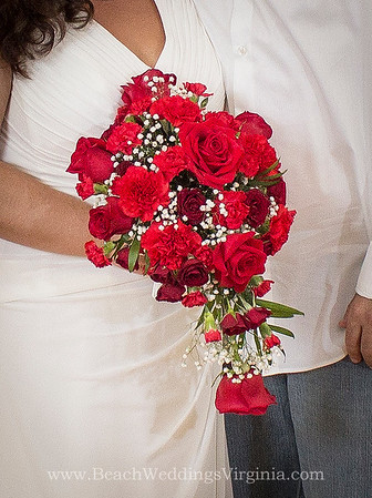 Red roses, dark red spray roses, red carnations, with baby's breath, cascading