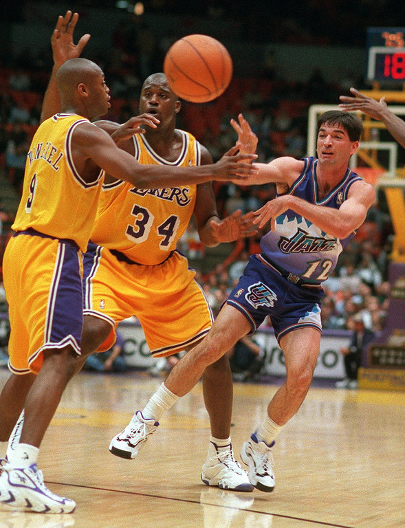. Shaquille O\'Neal (34) and teammate Nick Van Exel (9) of the Los Angeles Lakers attempt to block the pass of John Stockton of the Utah Jazz, right, during the first half of their game Wednesday night, Nov. 20, 1996, in Inglewood, Calif. (AP Photo/Mark J. Terrill)