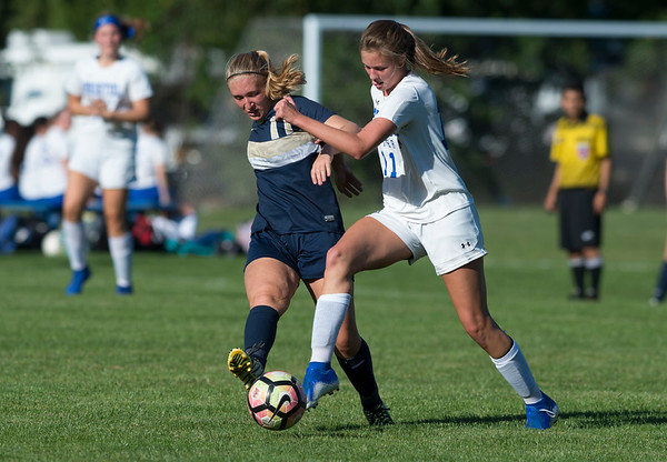 09/17/19 Wesley Bunnell | StaffrrBristol Eastern vs Newington soccer on Tuesday afternoon at Newington High School. Newington's Emily Chojnicki (17) and Bristol Eastern's Ciara Collins (11).