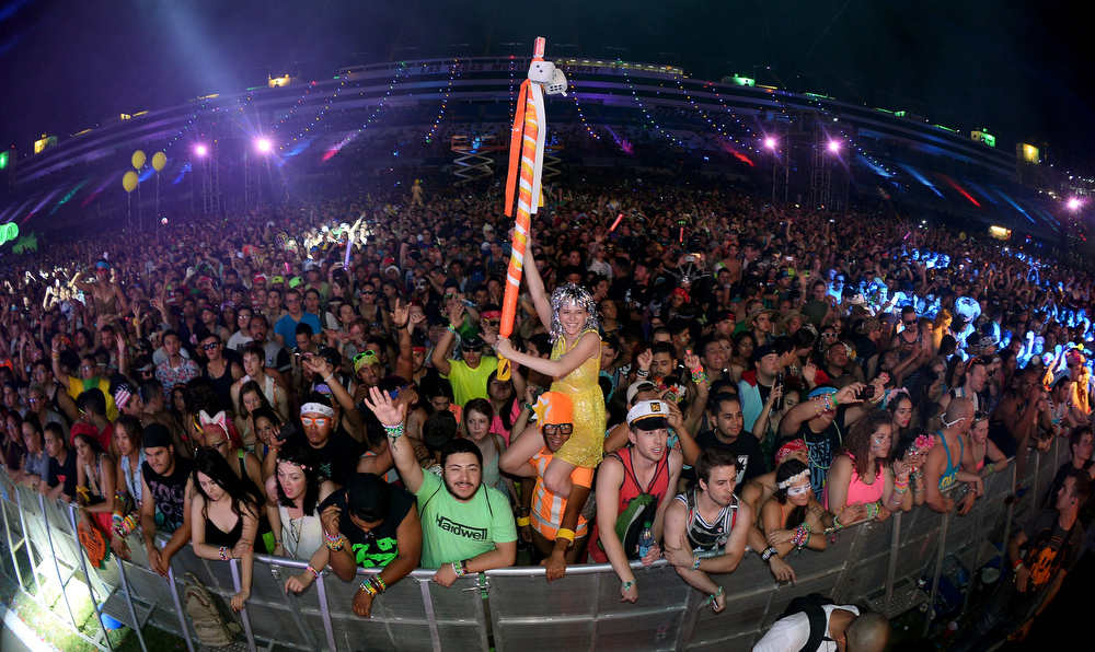 . Lacy Knaffla (C) of Nevada sits on the shoulders of Dave Levy of Nevada as they watch Empire of the Sun perform at the 17th annual Electric Daisy Carnival at Las Vegas Motor Speedway on June 22, 2013 in Las Vegas, Nevada.  (Photo by Ethan Miller/Getty Images)