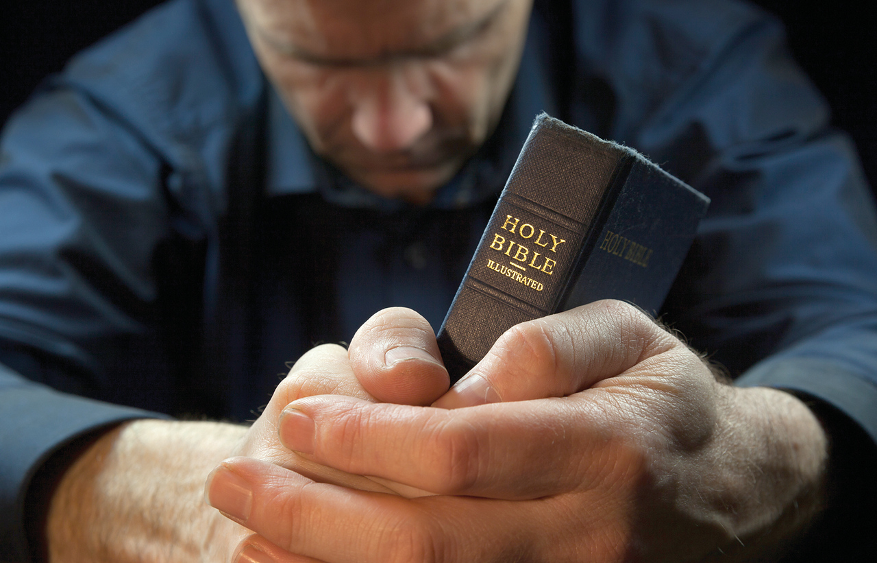 //www.dreamstime.com/stock-photos-man-praying-holding-bible-holy-image33032453