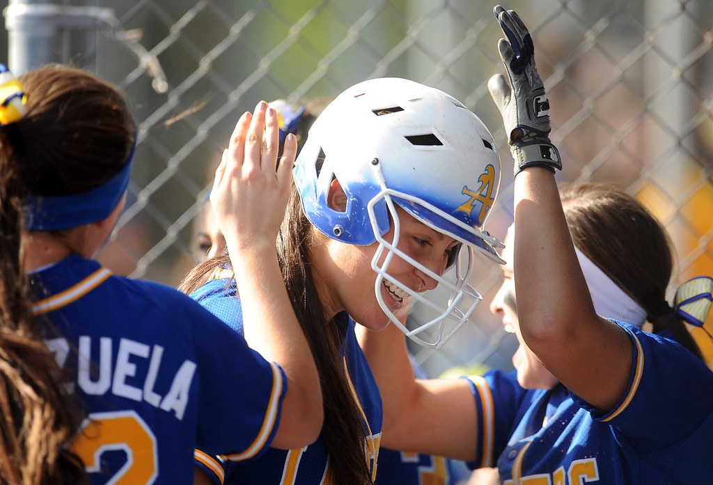 . in the first inning of a prep softball game at Bishop Amat High School on Wednesday, March 27, 2013 in La Puente, Calif. Bishop Amat won 5-3.  (Keith Birmingham Pasadena Star-News)
