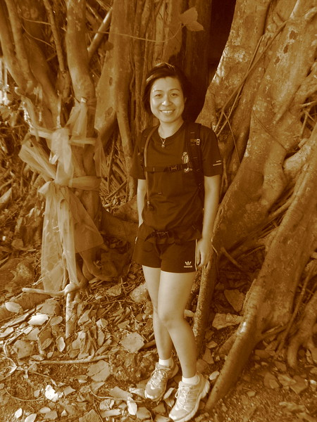Erika at the root-covered Wat Bang Koong
