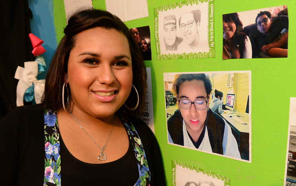 . Transgender student, Staceyy Holidayy, 15, formerly Roberto Valencia, who received a two-day suspension on Wednesday for a dress code violation at El Rancho High School in Pico Rivera, Calif., stands next to photos of herself last year on Friday January 10, 2014. Holidayy, formerly Roberto Valencia, was told that she was not allowed to use the girl\'s restroom but had to use the restroom in the nurses office. (Staff Photo by Keith Durflinger/Whittier Daily News)