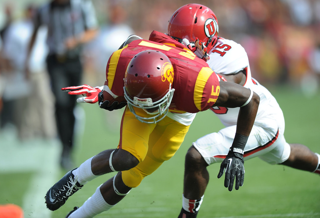. USC WR Nelson Agholor dives into the end zone for a first-quarter touchdown as Utah\'s Michael Walker defends, Saturday, October 26, 2013, at the L.A. Memorial Coliseum. (Michael Owen Baker/L.A. Daily News)
