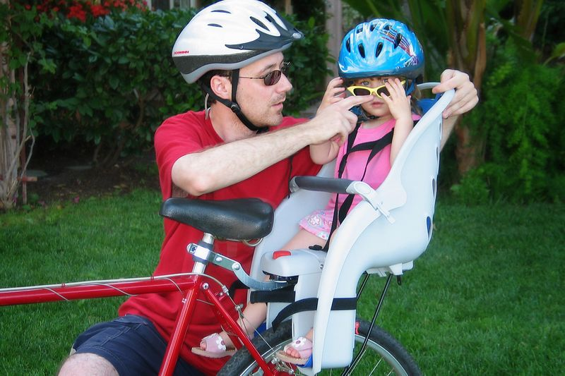 5/22 - We got a bicycle seat for Lili, she enjoys riding together. The helmet is required by California state law!