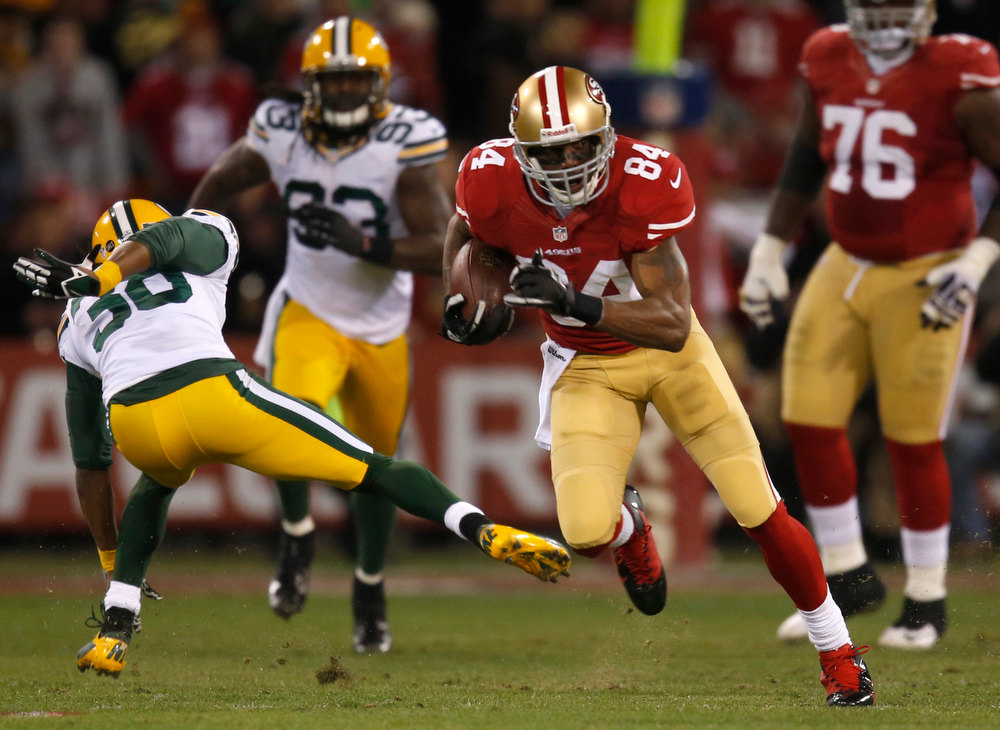 Description of . The San Francisco 49ers' Randy Moss (84) runs after a catch against the Green Bay Packers in the first quarter in the NFC Divisional Playoff on Saturday, January 12, 2013, at Candlestick Park in San Francisco, California. (Nhat V. Meyer/San Jose Mercury News)