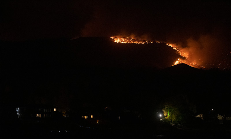 The Cameron Peak Fire, the largest wildfire in Colorado history, burns through the trees outside Loveland, Colo. on Saturday, Oct. 17, 2020.