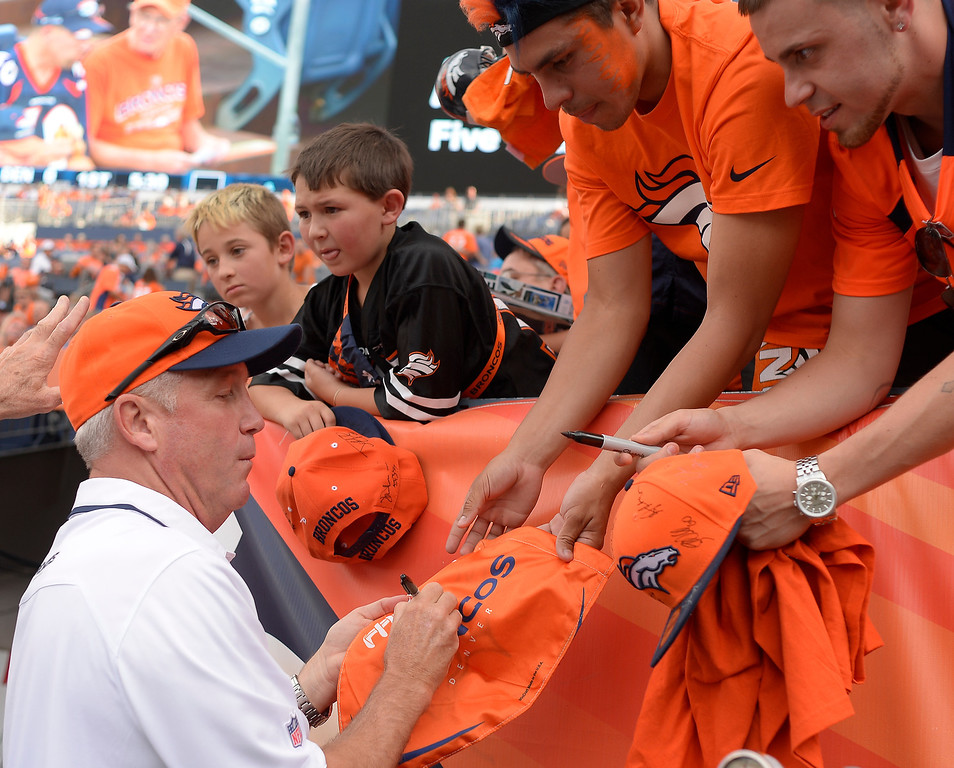 . DENVER, CO - SEPTEMBER 05: Denver Broncos head coach John Fox signs autographs before the game. The Denver Broncos took on the Baltimore Ravens in the first game of the 2013 season at Sports Authority Field at Mile High in Denver on September 5, 2013. (Photo by John Leyba/The Denver Post)