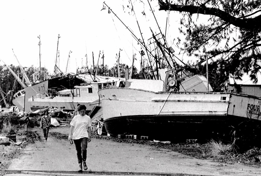 . A girl walks past destroyed shrimp boats after Hurricane Hugo hit McClellanville, S.C., in this Sept. 27, 1989 photo. (AP Photo/Chris O\'Meara)