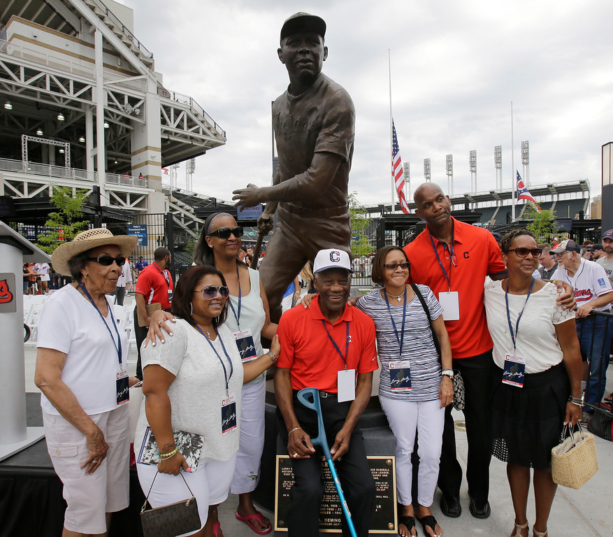 ". Larry Doby Jr., second from right, along with his family and James Timothy ""Mudcat\"" Grant, center, a former Major League Baseball pitcher are shown after the unveiling of a statue of Hall of Fame Larry Doby Saturday, July 25, 2015, in Cleveland. Doby broke the color barrier in the AL on July 5, 1947, just months after Jackie Robinson played for the Brooklyn Dodgers. Doby spent nine seasons with Cleveland and helped lead the Indians to a World Series title in 1948. He had a career .283 average with 253 homers. He led the league with 32 homers and 126 RBIs in 1954, when the Indians won 111 games. Before joining the Indians, Doby starred for Newark in the Negro League. He retired following the 1959 season. Doby\'s No. 14 was retired in 1994, 47 years after he was signed by Indians owner Bill Veeck. A seven-time All-Star, Doby died in 2003 at the age of 79. (AP Photo/Tony Dejak)"