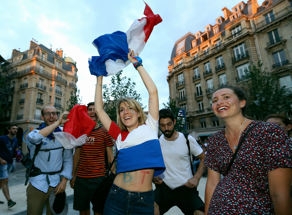 . Supporters celebrate after France won the soccer World Cup final between France and Croatia, Sunday, July 15, 2018 in Paris. France won its second World Cup title by beating Croatia 4-2 . (AP Photo/Bob Edme)