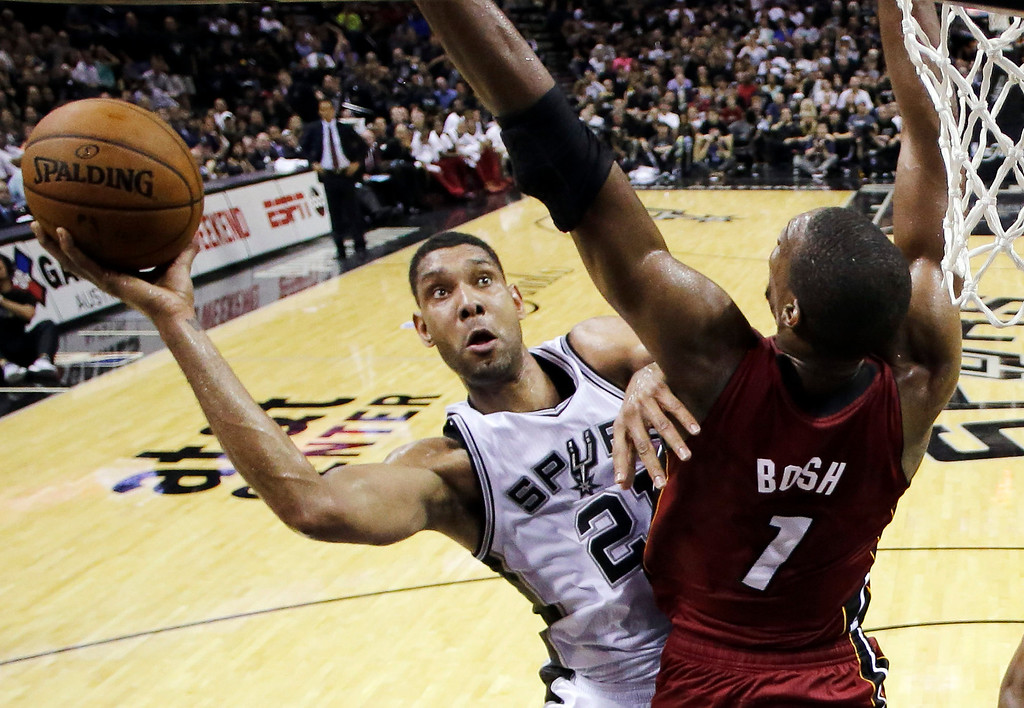 . San Antonio Spurs forward Tim Duncan (21) shoots over Miami Heat center Chris Bosh (1) during the first half in Game 1 of the NBA basketball finals on Thursday, June 5, 2014, in San Antonio. (AP Photo/Eric Gay, Pool)