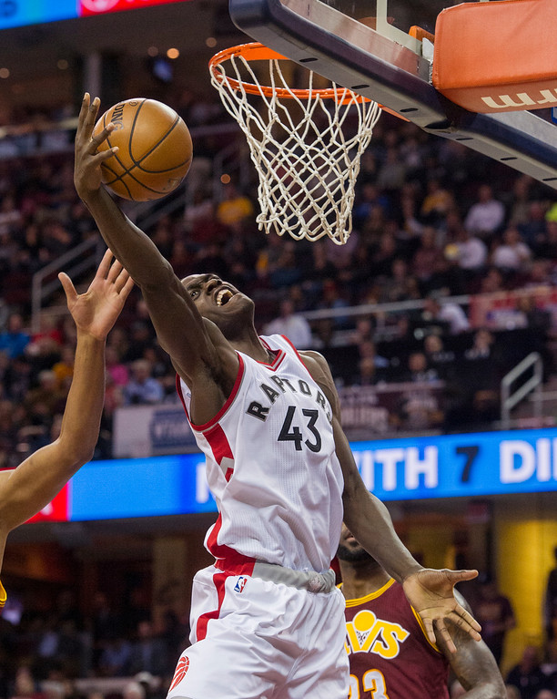 . Toronto Raptors\' Pascal Siakam (43) grabs a rebound against the Cleveland Cavaliers during the first half of an NBA basketball game in Cleveland, Tuesday, Nov. 15, 2016. (AP Photo/Phil Long)