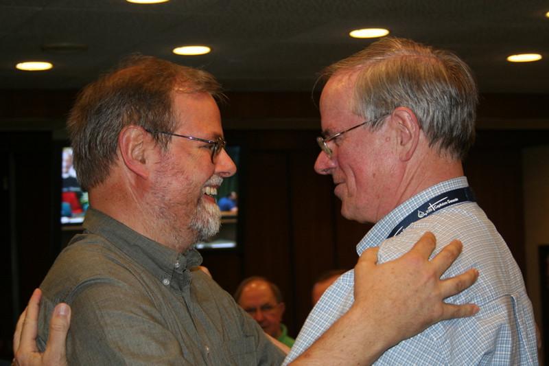 Fellow councilor Fr. Claudio Dalla Zuanna welcomes Fr. John van den Hengel to the council.