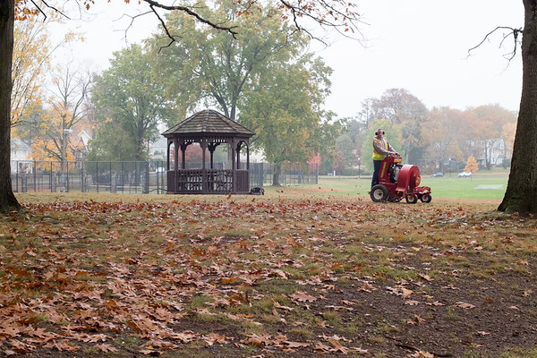 10/30/19 Wesley Bunnell | StaffrrA city worker uses a riding leaf blower to clean up Walnut Hill Park on October 30, 2019.