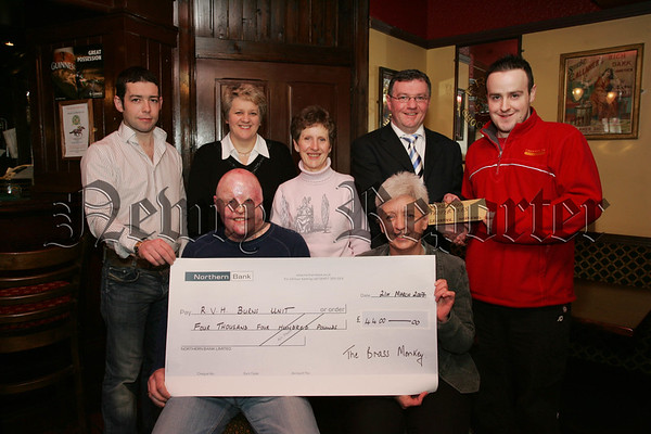 Ronan Bradley presents Ethna Teeney from the burns unit at the Royal Victoria Hospital with a cheque for £4400 which was the proceeds of a fundraising night held in the Brass Monkey and Sponsored by Moneytree Properties. Also pictured are, Peter McCaul, Maxine Shaw, Margaret Higgens, Gerard Mcmahon and Caolin Smith. 07W13N1