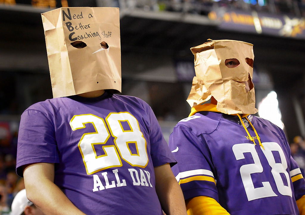 . Two Minnesota Vikings fans show how they feel about their team and its coaching coaching staff during the last minute of the 44-31 loss to the Green Bay Packers on Sunday night, Oct. 27, 2013, at the Metrodome in Minneapolis. (Pioneer Press: Sherri LaRose-Chiglo)
