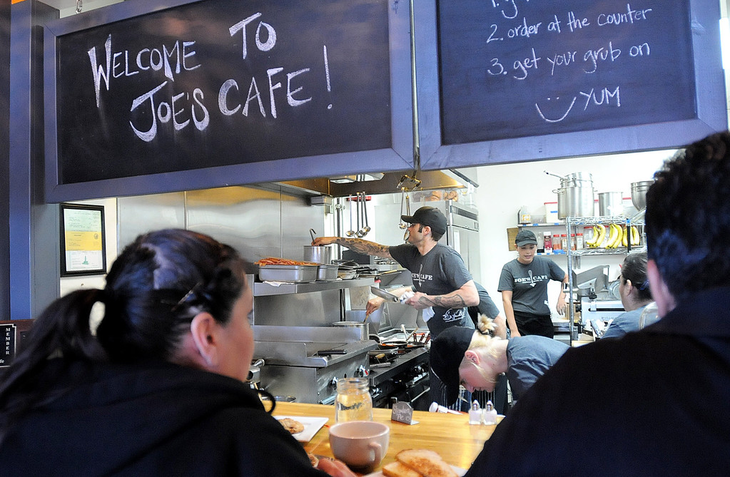 """. Customers watch a busy kitchen at Joe\'s Cafe in Granada Hills, CA on Wednesday, March 19, 2014.  Chef and Co-owner Joe Wetherbee won the Food Network\'s \""""Chopped, \""""Dread and Breakfast\"""" episode which aired on Tuesday night.  (Photo by Dean Musgrove/Los Angeles Daily News)"""
