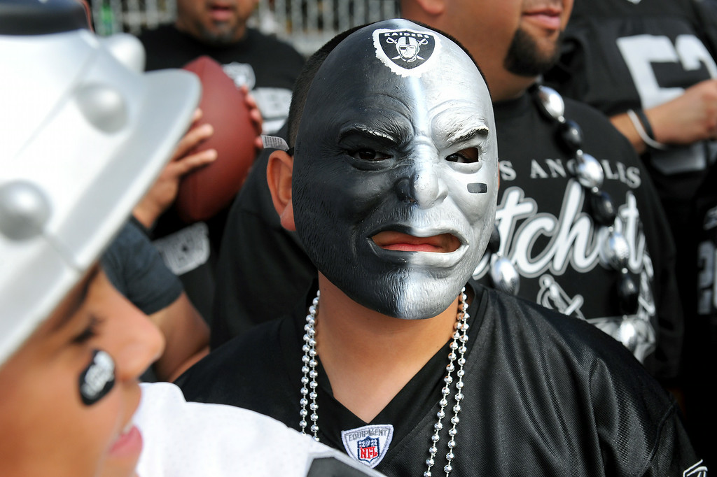 . Jacob Pech, 11, of Oxnard, wears a mask to the Cowboys-Raiders practice in Oxnard, Wednesday, August 13, 2014. (Photo by Michael Owen Baker/Los Angeles Daily News)