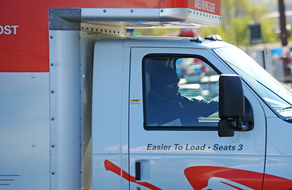 . Drug Enforcement Agency agent drives away in U-Haul moving after loading items into the truck during a raid at VIP Cannabis, located at 2949 W. Alameda Ave., April 30, 2014. The marijuana dispensary was previously raided in November 2013. (Photo by RJ Sangosti/The Denver Post)
