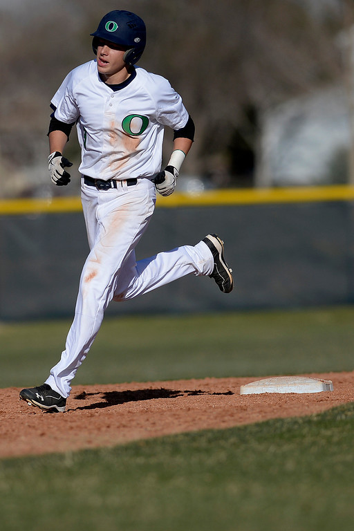 . Aurora, CO - APRIL 08: Joe Slocum (3) of the Overland Trailblazers rounds second after hitting a game-tying, three-run home run off of Cody Wood (4) of the Cherry Creek Bruins. Overland hosted Cherry Creek on Tuesday, April 8, 2014. (Photo by AAron Ontiveroz/The Denver Post)