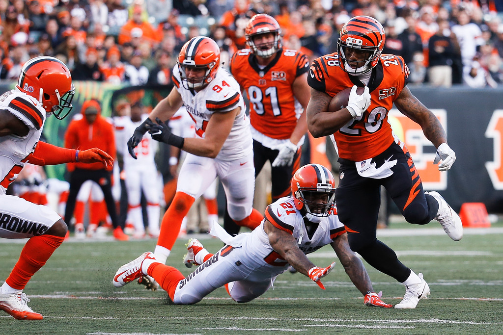 . Cincinnati Bengals running back Joe Mixon (28) runs the ball past Cleveland Browns cornerback Jamar Taylor (21) in the second half of an NFL football game, Sunday, Nov. 26, 2017, in Cincinnati. (AP Photo/Frank Victores)