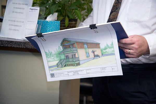 02/07/20 Wesley Bunnell | StaffrrSenator Richard Blumenthal visited Neighbor Works at 223 Arch St on Friday afternoon to announce federal grant money which has been allocated to the program. NHS of New Britain's Finance Director Ed Loggins holds sketches of homes during a presentation on upcoming housing construction.