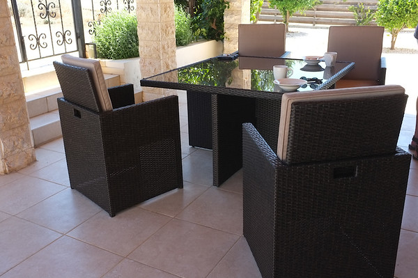 Front patio with outdoor table and chairs