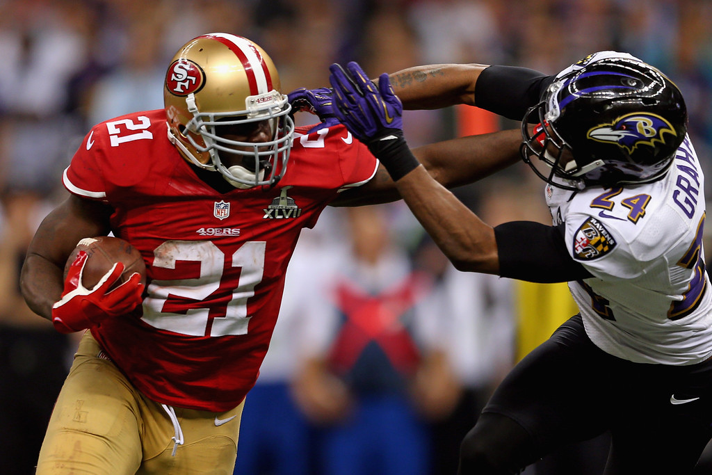 . Frank Gore #21 of the San Francisco 49ers breaks a tackle against Corey Graham #24 of the Baltimore Ravens as he runs for a touchdown in the second half during Super Bowl XLVII at the Mercedes-Benz Superdome on February 3, 2013 in New Orleans, Louisiana.  (Photo by Mike Ehrmann/Getty Images)