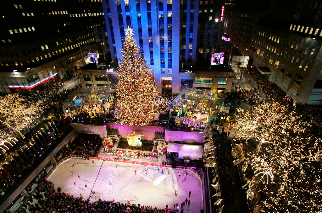 . The Rockefeller Center Christmas tree stands lit in front of the General Electric building in New York\'s Rockefeller Plaza during the 73rd annual tree lighting ceremony Wednesday, Nov. 30, 2005, in New York. The 74-foot-tall Norway Spruce from Wayne, N.J. weighs nine tons and is topped with a Swarovski star.  (AP Photo/Frank Franklin II)