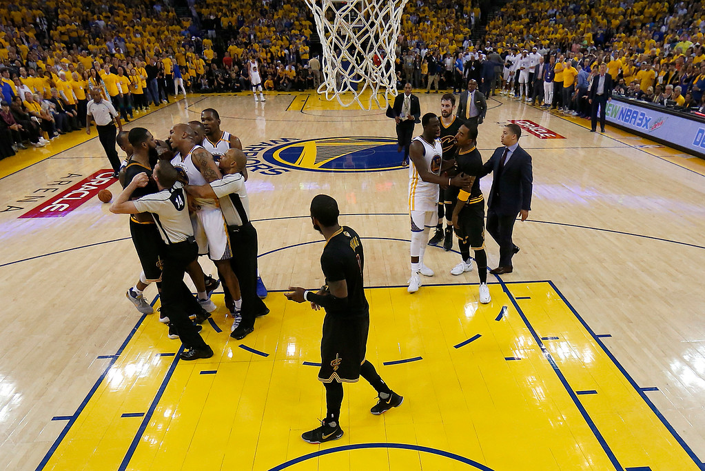. Players and referees separate Cleveland Cavaliers center Tristan Thompson and Golden State Warriors forward David West, at left, during the first half of Game 5 of basketball\'s NBA Finals in Oakland, Calif., Monday, June 12, 2017. (AP Photo/Marcio Jose Sanchez, Pool)
