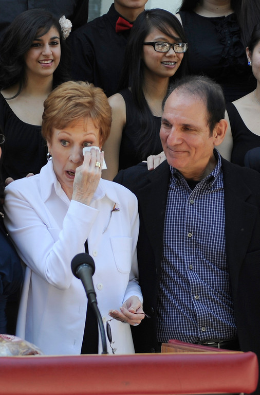 """. Carol Burnett shows her emotion after listening to the choir sing. Burnett stands next to Stormy Sacks, the director of the performing arts magnet at Hollywood High School. Burnett, award-winning actress, comedienne and best-selling author, was honored by the City of Los Angeles for her lifetime achievements with the naming of Carol Burnett Square at the intersection of Highland Avenue and Selma Avenue. The Square is adjacent to Hollywood High School where Burnett attended. Students from the school choir, \""""H2O\"""" sang �I�m so glad we had this time together,� before Burnett and LA City Councilman Tom LaBonge unveiled her street sign. Hollywood, CA 4/18/2013(John McCoy/Staff Photographer"""