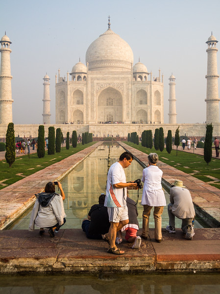 Tourist Taking Photos Of The Taj Mahal In Front Of The Reflecting Pool, Agra, India, Asia