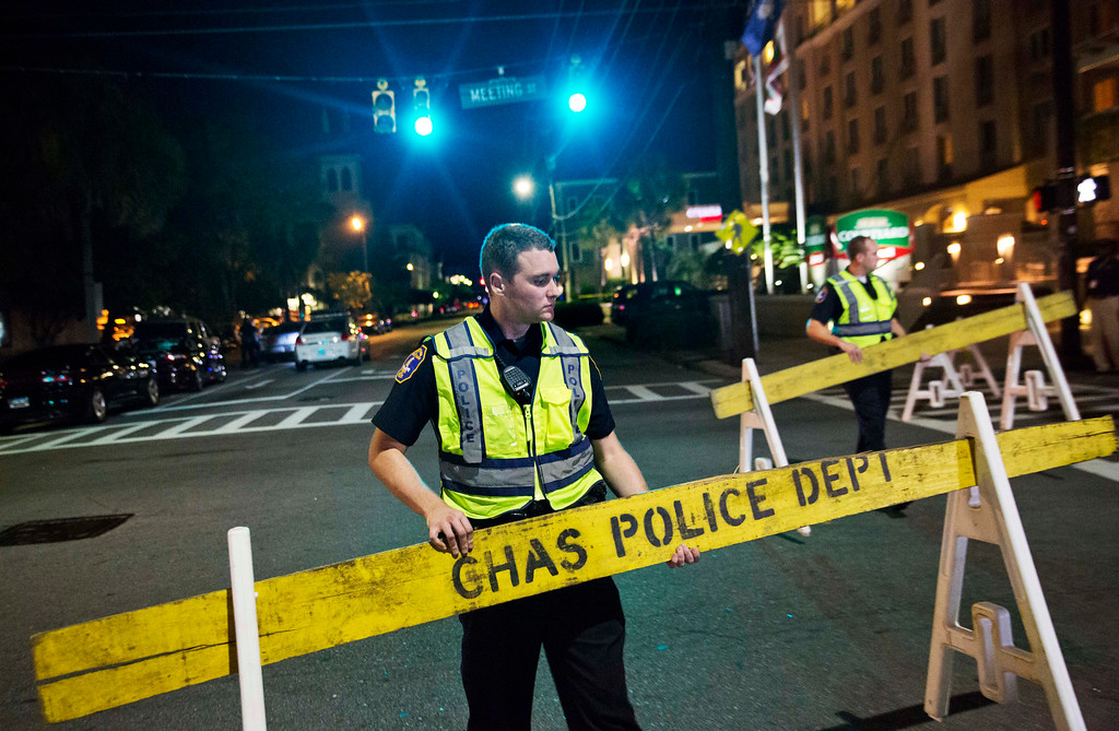 . Police close off a section of Calhoun Street near the Emanuel AME Church following a shooting Wednesday, June 17, 2015, in Charleston, S.C. (AP Photo/David Goldman)