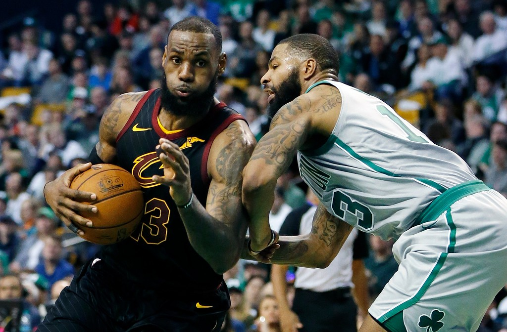 . Cleveland Cavaliers\' LeBron James (23) drives past Boston Celtics\' Marcus Morris (13) during the third quarter of an NBA basketball game in Boston, Sunday, Feb. 11, 2018. The Cavaliers won 121-99. (AP Photo/Michael Dwyer)