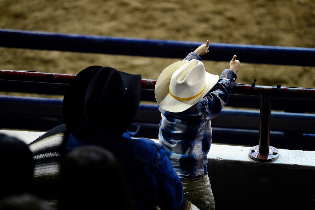 . A youngster gives his approval with a double thumbs up during the National Western Stock Show\'s Mexican Rodeo Extravaganza at the Denver Coliseum on Sunday, Jan. 13, 2013. AAron Ontiveroz, The Denver Post