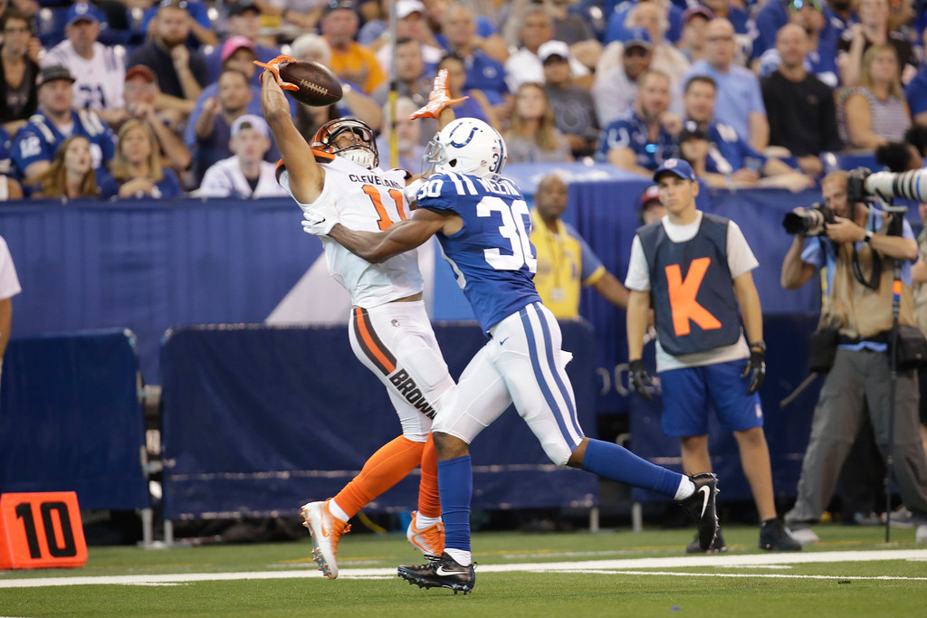 . Cleveland Browns wide receiver Jordan Leslie (11) makes a catch over Indianapolis Colts cornerback Rashaan Melvin (30) during the first half of an NFL football game in Indianapolis, Sunday, Sept. 24, 2017. (AP Photo/AJ Mast)