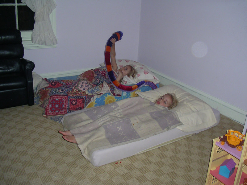 The twins in their beds.