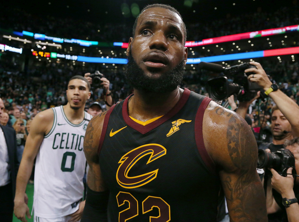 . Cleveland Cavaliers forward LeBron James off the court after embracing Boston Celtics forward Jayson Tatum (0) following the Cavaliers\' 87-79 victory in Game 7 of the NBA basketball Eastern Conference finals, Sunday, May 27, 2018, in Boston. (AP Photo/Elise Amendola)