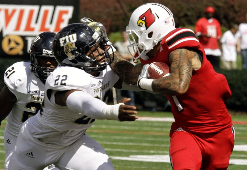". <p>10. (tie) FLORIDA INTERNATIONAL PANTHERS <p>Asked for a running clock in 72-0 loss to Louisville. How very, very Little League. (unranked) <p><b><a href=\'http://college-football.si.com/2013/09/21/fiu-louisville-running-clock/\' target=""_blank\""> HUH?</a></b> <p>    (AP Photo/Garry Jones)"