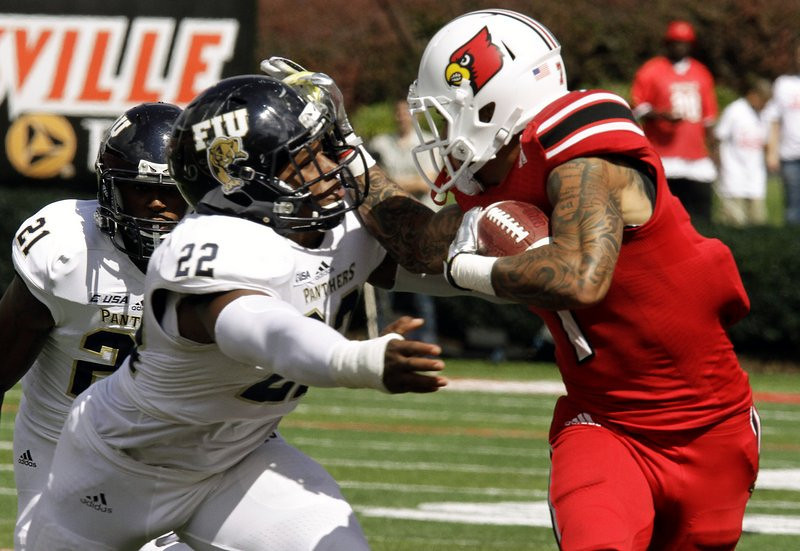 """. <p>10. (tie) FLORIDA INTERNATIONAL PANTHERS <p>Asked for a running clock in 72-0 loss to Louisville. How very, very Little League. (unranked) <p><b><a href=\'http://college-football.si.com/2013/09/21/fiu-louisville-running-clock/\' target=\""""_blank\""""> HUH?</a></b> <p>    (AP Photo/Garry Jones)"""