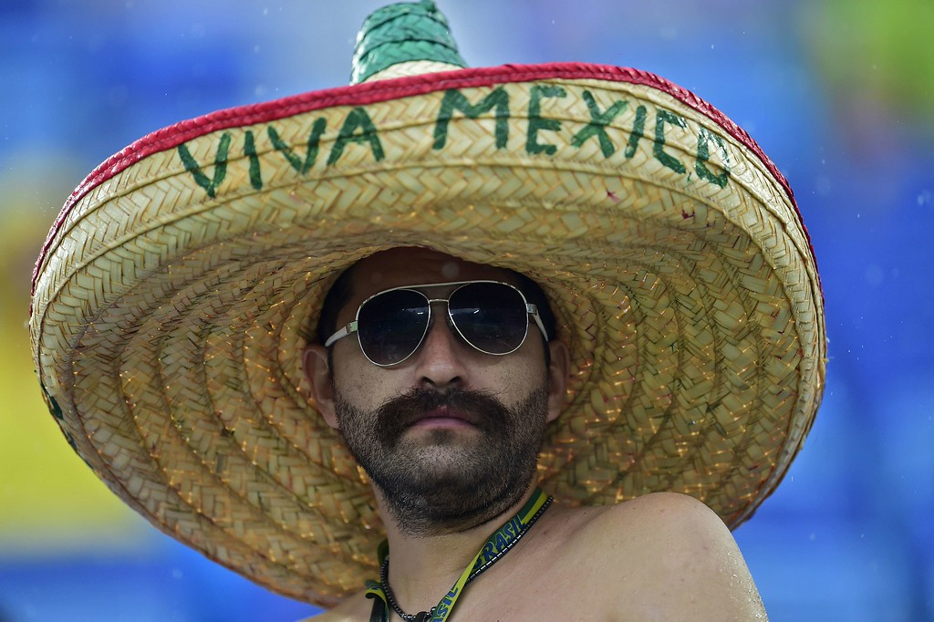 . A Mexican fan is pictured before the Group A football match between Mexico and Cameroon at the Dunas Arena in Natal during the 2014 FIFA World Cup on June 13, 2014. AFP PHOTO / PIERRE-PHILIPPE MARCOU/AFP/Getty Images
