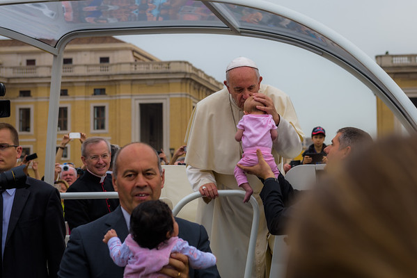 Our baby Claire being kissed by Pope Francis