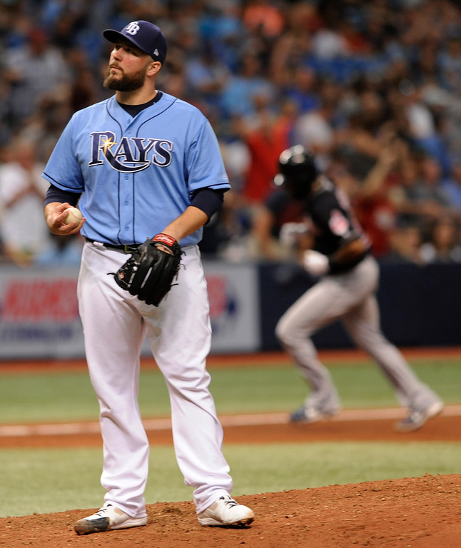 . Tampa Bay Rays reliever Tommy Hunter, left, holds a new baseball after giving up a solo home run to Cleveland Indians\' Austin Jackson, right, during the eighth inning of a game Sunday, Aug. 13, 2017, in St. Petersburg, Fla. (AP Photo/Steve Nesius)