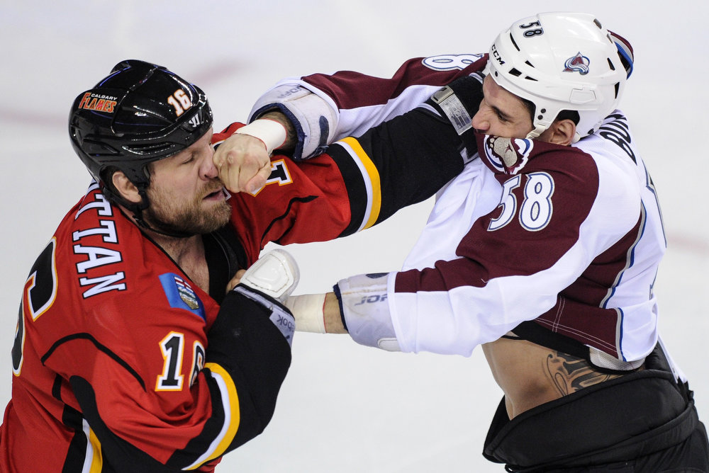 . Colorado Avalanche\' Patrick Bordeleau (58) lands a punch on Calgary Flames\' Brian McGrattan during the first period of their NHL hockey game in Calgary, Alberta, March 27, 2013. REUTERS/Mike Sturk