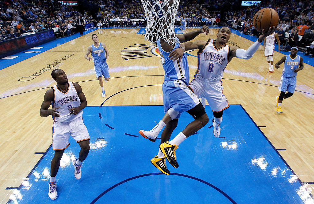 . Oklahoma City Thunder Oklahoma City Thunder shoots in front of Denver Nuggets forward Kenneth Faried (35) and teammate Serge Ibaka (9) in the third quarter of an NBA basketball game in Oklahoma City, Tuesday, March 19, 2013. Denver won 114-104. (AP Photo/Sue Ogrocki)