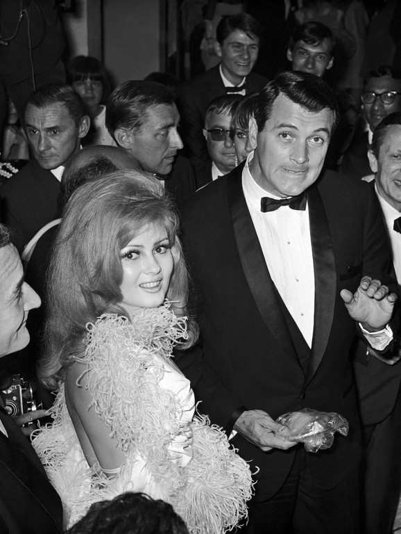 ". American actors Pamela Tiffin and Rock Hudson, the star of the film ""Seconds\"" arrive at the Cannes Film Festival, France on May 16, 1966. (AP Photo)"