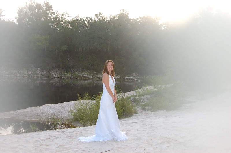 Marina at the river in Wedd dress